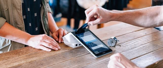 Photo of Poynt Terminal accepting chip card payment