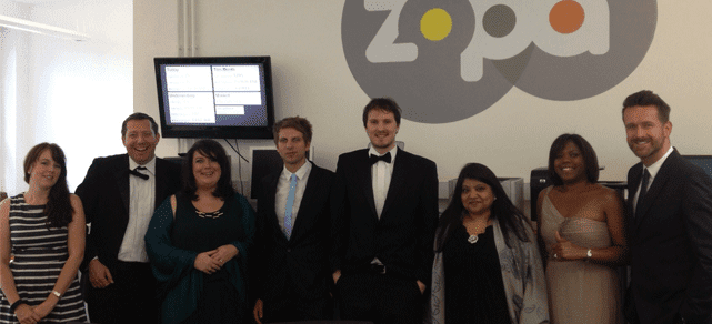 Photo of Zopa employees celebrating an award