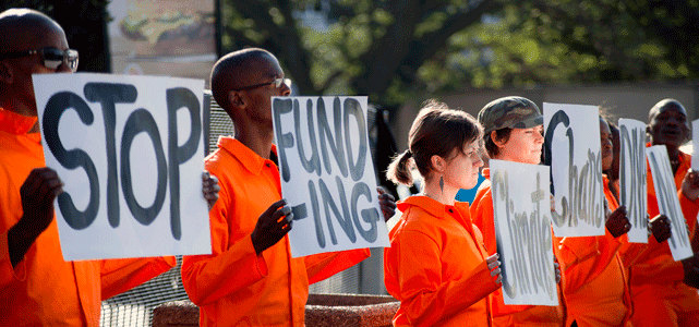 Photo of Protestors Against Fossil Fuel Funding