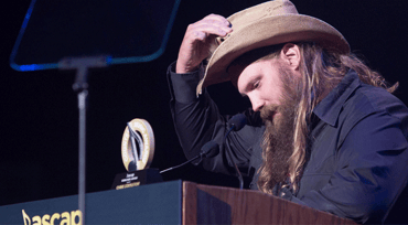 Photo of Chris Stapleton accepting an award at the ASCAP Country Music Awards