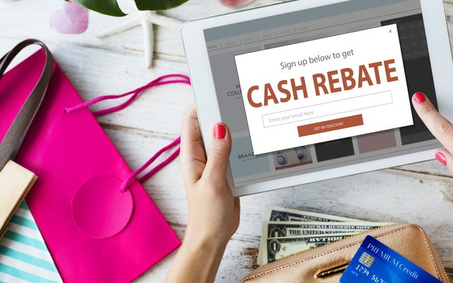 Stock photo of cash rebate on a tablet