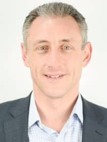 Headshot of Mark Delgado, General Manager at Mitratech