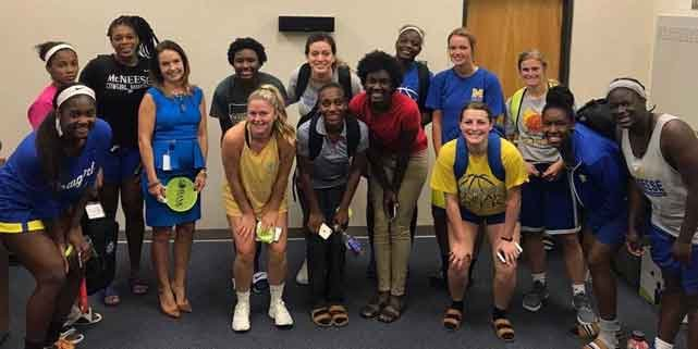 Photo of Dawn Primeaux with McNeese State women's basketball team