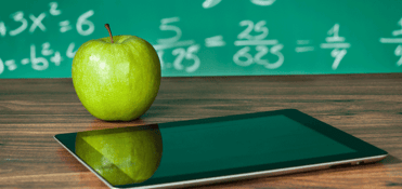An apple on a teacher's desk