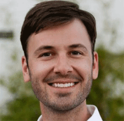 Portrait of Adam Wozney, Community and Partnership Manager for Wix