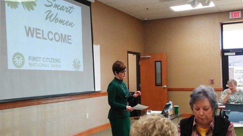 Photo of Judy Long, FirstCNB President and COO, speaking at a Smart Women class in Tennessee