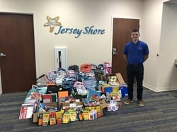 Jersey Shore Federal Credit Union's Garrett Garcia pictured with 2018 Tools for Schools Donations
