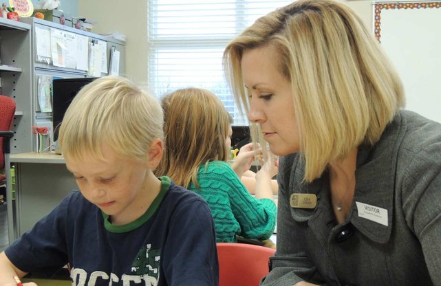 Photo of Service One Credit Union employee helping student