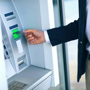 Photo of a Man at an ATM Machine