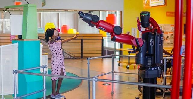 Photo of kid participating in DoSeum exhibit