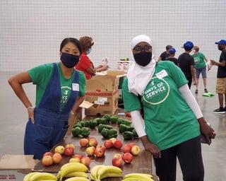 Photo of YMCA workers distributing food