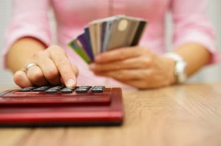 Woman Calculating Credit Card Debt