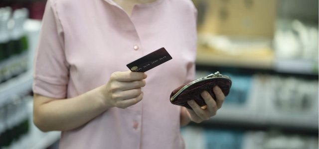 Picture of a woman holding a credit card