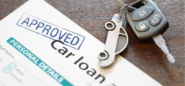 Car loan application and keys.