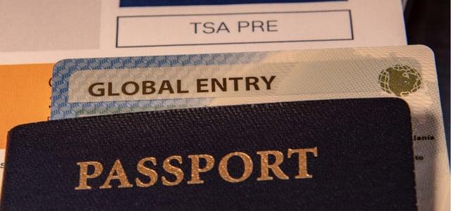 Photo of a passport, Global Entry card, and TSA Precheck paper.