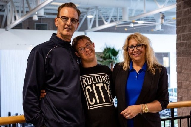 A photo of Chris Nikic with the KultureFit team.