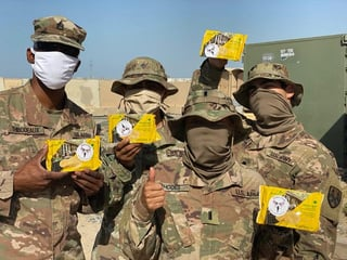 Photo of service members holding good from Soldiers' Angels