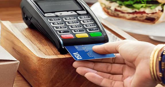 USA Today photo of a person paying with an EMV-chip card.