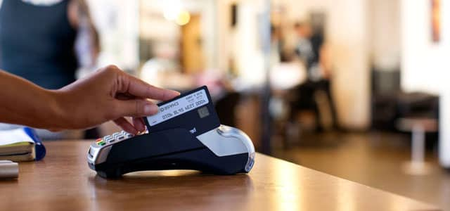 Image of Plastc Card being swiped through POS machine