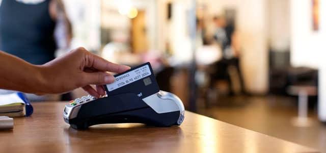Image of Plastc Card being swiped through POS machine