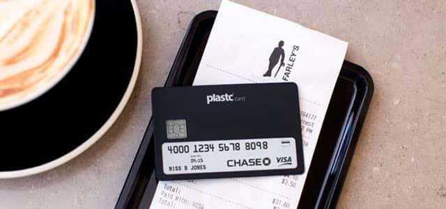 Image of Plastc Card on restaurant payment tray