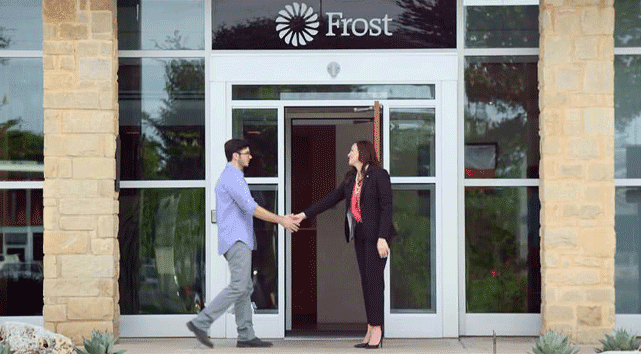 Photo of a Frost Bank employee greeting a customer