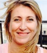Headshot of Alexandra Origet du Cluzeau, Global PR Director at HomeExchange