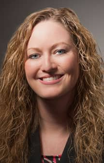 Headshot of Carrie Wilkie, SVP of Standards Management at GS1
