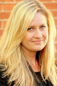 Headshot of Corinne McDermott, Founder of Have Baby Will Travel