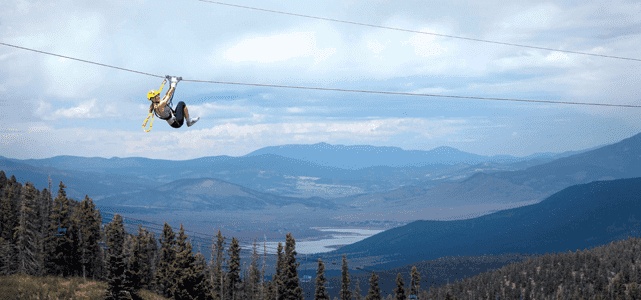 Woman Zip-Lining at Angel Fire Resort