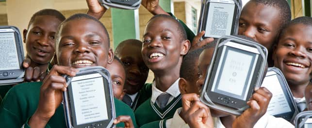 A Photo of Students Holding E-Reader Devices