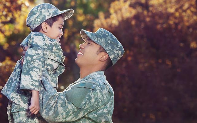 Photo of a veteran with child