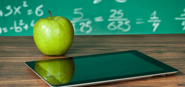 An apple on a teacher's desk