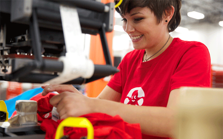 Photo of a CustomInk Inker working on production