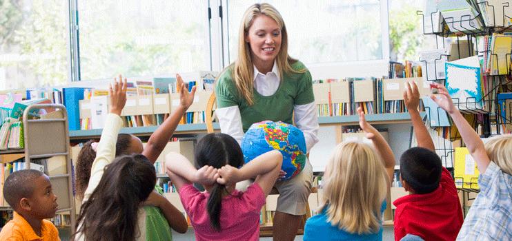 Kids raising their hands in class
