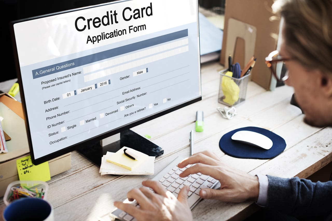 Photo of a person applying for a credit card online