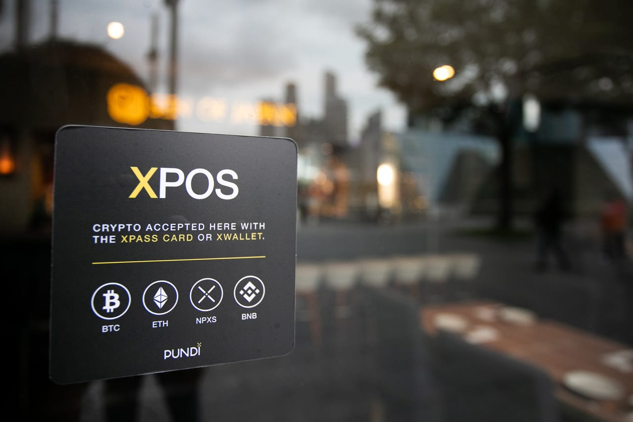 Photo of Pundi X Sign on Merchant Window