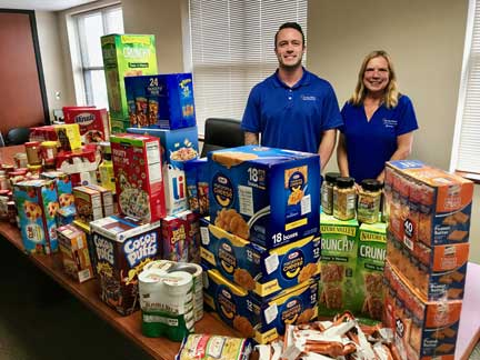Brandon Favro and Jeannie Straub from Jersey Shore FCU's Social Action Committee pictured at the 2018 Kid-Friendly Food Drive