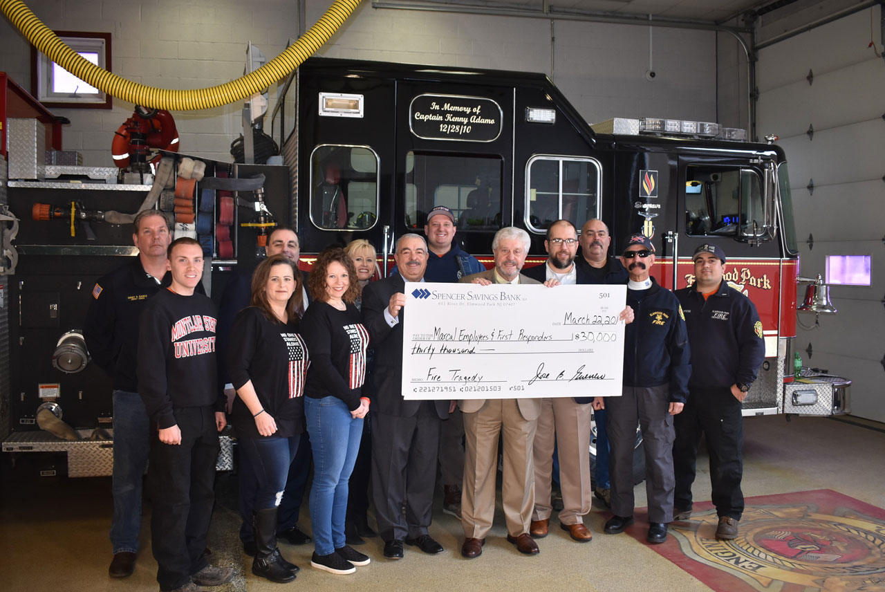 Photo of Spencer Savings Bank employees donating a check to Marcal employees and first responders