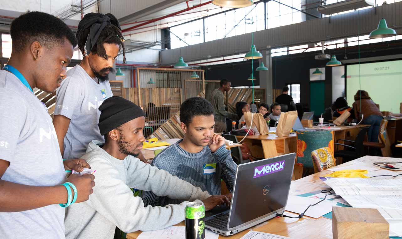 Photo of group working on a MEST project