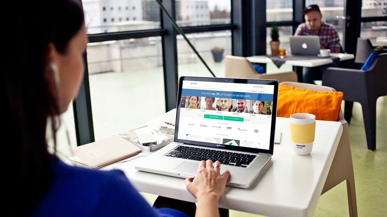 Photo of woman using Toptal site