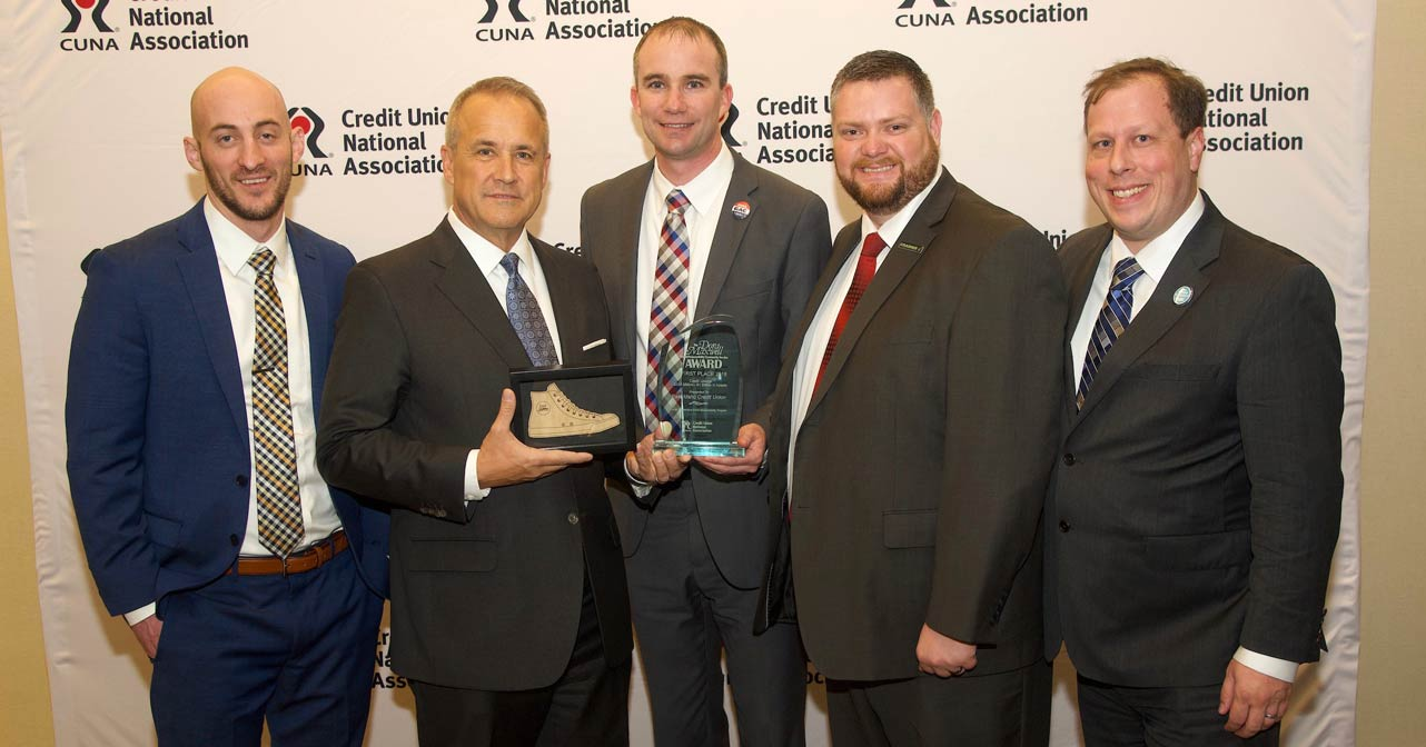 Photo of EICU management being presented with CUNA award